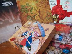 Make a pile of boxes from old record sleeves by Sword in the Stove, via Flickr