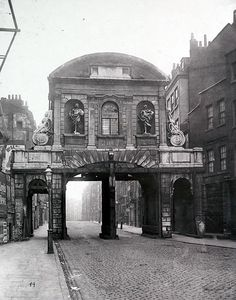 Temple Bar was a gateway to the City of London, marking its western edge on Fleet St. Wren's construction was taken down in 1878, shortly after this photograph was taken.