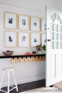 When there's little room in an entryway, install a wall shelf and create an art wall or gallery