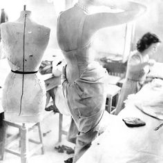 Mannequin, model and seamstress ... #richardavedon's light-drenched image of the #Dior atelier in 1947 shows us the behind the scenes realisation of a dress.  The fit model stands with arms raised - as anonymous as the #stockmandummy beside her. But her flesh is warm and real and fills the elaborate gown with life.  #1940sfashion #newlook #christiandior #parisfashion #hautecouture #vintagefashion #dresshistory #fashionhistory #fashionstudies