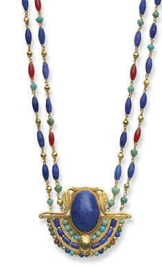 AN EGYPTIAN-REVIVAL MULTI-GEM AND GOLD NECKLACE, BY LOUIS COMFORT TIFFANY, TIFFANY & CO. -  Suspending a pendant, bezel-set with an oval cabochon lapis lazuli, framed along the bottom by a three-tiered arch of turquoise, lapis lazuli, amber and gold beads, accented by sculpted gold asps and a scarab, to the double-strand neckchain of gold, lapis lazuli, turquoise and amber beads, joined by a sculpted gold clasp, mounted in gold, circa 1913.