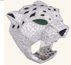 Panthere de Cartier ring in white gold with pave diamonds, emerald eyes, and an onyx nose.