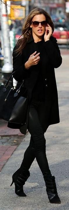 Who made Alessandra Ambrosio's black handbag, sunglasses, and ankle boots? Sunglasses – Thierry Lasry  Purse – Michael Kors  Shoes – Isabel Marant
