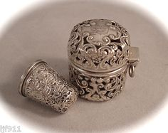 Antique UNGER BROTHERS Sterling Silver Chatelaine Thimble Case w/Henckels Thimble ~ The Unger family immigrated to Newark, NJ in 1849 from Germany. The oldest son, Herman, established a jewelry business between 1870-1872 and began the manufacture of sterling silver items in 1878. In time all five sons joined the company. This firm reached its economic zenith from 1895 to 1907. Thimble by J.A.Henckels, Germany