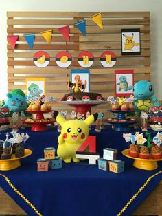 Intersperse purple traingles, hang purple tablecloth like navy is in pic, yellow tablecloth underneath. Notice how Pokeball banner doesn't need inner circle