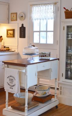 Looks like a whitewashed sewing table repurposed. Cynthia's Cottage Design