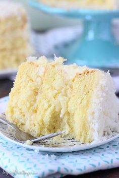 There's too much to love about this Coconut Custard Cake. Layers of coconut cake (from scratch), a simply coconut custard and finished with a cream cheese frosting. The whole cake is covered with sweetened coconut. Coconut Cake From Scratch, Lemon And Coconut Cake, Coconut Desserts, Coconut Custard, Custard Cake, Coconut Recipes, Just Desserts, Delicious Desserts, Coconut Cakes