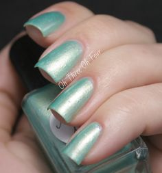 Make a Mint is a gold-shifting mint accented with pink shimmer and iridescent blue-green microglitter. Shown is 2 coats with top coat.