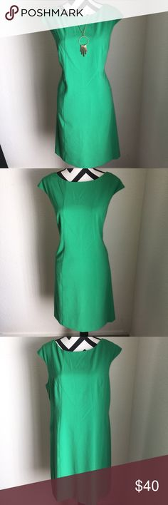 "Vince Camuto dress 👗 Chic green dress in excellent condition size 14 ••bust 19 1/4""••waist 20 1/2""•• shoulder to hem 37""•• 63% polyester 32% rayon 5% spandex••does have some stretch to it••• measurements are approximate••measured flat and not stretched•••Vince Camuto Vince Camuto Dresses Midi"