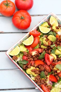 Taco Salad Recipe {Paleo + Whole30 Friendly} Ingredients for this healthy and simple dinner meal includes avocado, tomatoes, seasoned beef, romaine, cilantro, red onions and fresh squeezed lime.