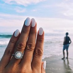The secret to an enviable engagement ring photo isn't about the background or even the rock itself, at least not entirely: it's about having the perfect polish color or manicure to go with your sparkler. Try this: Whiteout