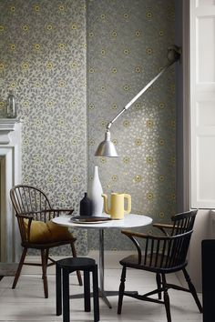 Wallpaper: Richmond Green Shutters painted in: French Grey Pale 161 Side wall painted in: Dark Lead Colour 118 Skirting painted in: French Grey 113 Floor painted in: French Grey Mid 162 Teapot vase painted in: Lemon Tree 69