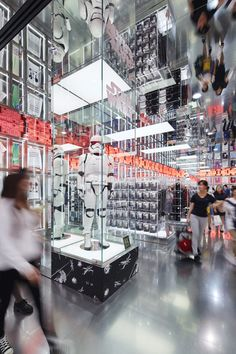 "The fifth floor of UNIQLO flagship store in Shanghai that was completed in 2013 has been renewed to promote the brand's ""Disney Project. "" Reflecting the concept of ""UNIQLO's version of Disneyland for clothes,"" the floor is designed into separate zones such as ""main entrance,"" ""Tomorrowland,"" and ""Adventureland."" By combining UNIQLO's playful shopping experience with Disney's characteristic entertainment quality, the space offers visitors the fun of traveling between different zones."