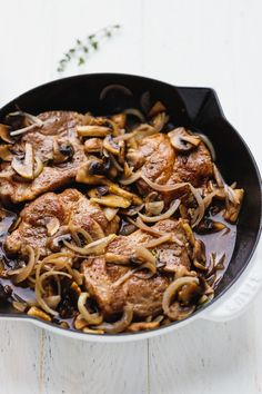 Baked Pork Steak Recipe - tender and juicy pork shoulder steaks, lightly browned on the stove top and then cooked in the oven together with mushrooms and onions for a quick and effortless meal. Very easy to make and delicious.