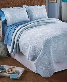 This Coastal-Quilted Bedding Set has an ocean-themed print that reminds you of life on the water. The pastel-colored set features decorative stitching with a seashell and starfish design. Each piece is finished with scalloped edges. King set includes kin