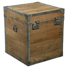 """Reclaimed elm wood trunk with iron banding.   Product: TrunkConstruction Material: Reclaimed elm and brushed ironColor: Natural and ironDimensions: 22"""" H x 19.5"""" W x 19.5"""" D"""