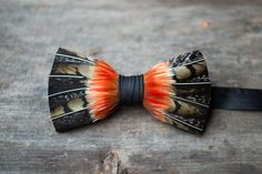 McKinney feather bow tie handmade in Charleston, South Carolina. Each feather is carefully chosen from a sustainable source and artfully designed on the tie.