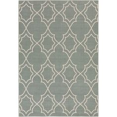Equally at home on the patio or in your foyer, this artful indoor/outdoor rug brings an eye-catching pop of style to your decor with its geometric trellis mo...