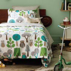 Earthy tones and an owl print make this bedding perfect for a boys' room