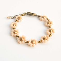 Darling Daisy Bracelet - Ivory | $39 | More color options available. #bridesmaids #flowergirl #handmade