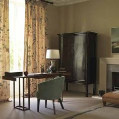 Lounge with home office-- Wallpaper in a subtle geometric pattern works beautifully with classic linen floral curtains and George Smith furniture upholstered in warm fabrics. A sleek walnut desk complements the scheme and adds a smart contemporary edge.