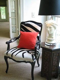 Palacek Camel Back Zebra Print Chair ($1,250). Made of high-quality zebra faux fur upholstery, the chair is built upon a black-wood, camel-s...