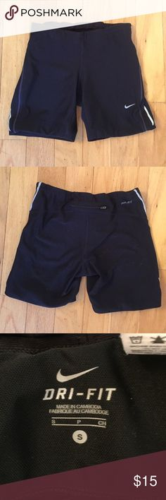 "Nike Dri-Fit Running Shorts Nike Dri-Fit Running Short. Tight black short with breathable mesh. Reflective panel on side of legs. Zipper in back to stow keys and/or ID. Gently worn. Inseam 6"". Runs small. Make me an offer! Nike Shorts"