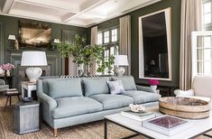 Living Room decor ideas - traditional blue and green living room with dark green walls, white boxed beam ceiling, light blue sofa, metal frame and stone top coffee table and traditional decor | Mix and Chic: Edie Parker founder Brett Heyman's beautiful Connecticut home