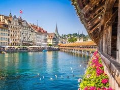 CHAPEL BRIDGE - LUCERNE   Located in central Switzerland, Lucerne is known for its Kapellbrücke (Chapel Bridge). The bridge was restored in the early 1990s after a fire destroyed most of it.  -bluejayphoto / iStock