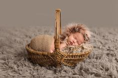 Babys face is framed in gorgeous soft feathers!    Ships in newborn size, unless you specify differently. An upcharge will occur for babies over 10