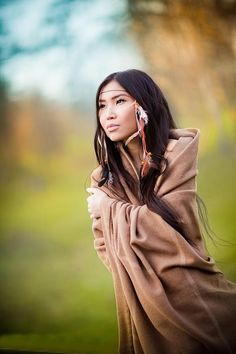 Elu may possibly be native american mixed with asian, she should be very pale and willowy but also have the hair and wider facial structure
