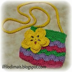 Little crochet bag with a flower embellishment attached to the front. Crochet Flowers, Picsart, Straw Bag, Embellishments, Knit Crochet, Crochet Necklace, Barbie, Purses, Christmas Ornaments