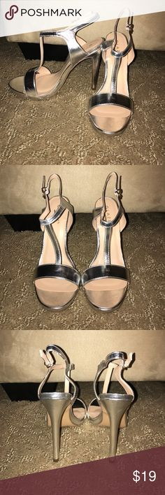 ✨NWOT✨Strappy silver heels ✨BRAND NEW--NEVER WORN✨ Strappy silver heels, buckle on the ankle. 5 inch heel height. Comes in mesh bag! Fashion Nova Shoes Heels