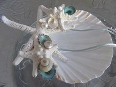 Beach Wedding Ring Bearers Shell with Starfish Turquoise Limpets and Pearl Umbonium Beautiful shell art for your beach wedding. a white Ring Holder Wedding, Ring Pillow Wedding, Wedding Rings, Wedding Pillows, Beach Flower Girls, Beach Wedding Colors, Wedding Renewal Vows, Candle Centerpieces, Candles