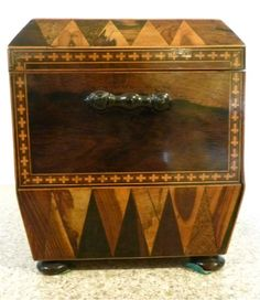 """Mid-19th century TUNBRIDGE-WARE TEA CADDY of large size. // The gabled lid is veneered in rosewood with profuse """"Van Dyke"""" pattern inlaid around, with matching parquetry to the front, whilst the sides are fitted with finely-turned solid rosewood handles. Original velvet lining inside, two parquetry lidded tea canisters. Matching Tunbridge-ware caddy spoon, in the shape of a saucepan ~ itself very rare. //  - Maria Elena Garcia -  ► www.pinterest.com/megardel/ ◀︎"""