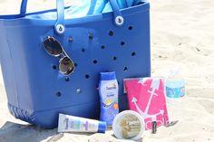 What's in your beach bag?  #boggbag #beachbag #bestbeachbagever #whatsinyourbag #noblo #rayban #sandgone #coppertone #nestle