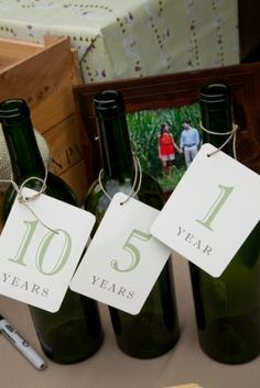 Take three empty wine bottles and ask guests to write you notes to read on your first, fifth and tenth wedding anniversaries. Very sweet!