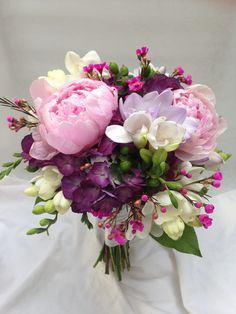 Late spring bouquet with peonies, hydrangea, freesia and waxflower