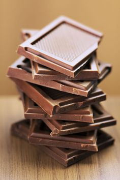 "Break into a bar of chocolate, then take over the world. A nip of it boosts your short-term productivity by 12%, according to a study in the Journal of Labor Economics. ""Chocolate makes people happier, and happy people may be less distracted by worry, so they get more done,"" theorizes lead researcher Andrew Oswald, Ph.D., professor of economics and behavioral science at the University of Warwick in England. Can't talk! Godiva!"