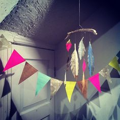 #paper #bunting #feather #mobile #driftwood @pressworksonpaper by ccerruti, via Flickr