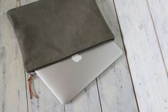 """This Beautiful Moss Green Leather Clutch Bag is made with Very soft & Unique Moss-Green Embossed cow leather. Thick Khaki Brown cotton canvas lining & Strong industrial YKK metal zipper closure with a leather pull.  It is very beautiful to carry on it's own but can use as a 13"""" Laptop ,MacBook Air 13"""" ,Leather case.  One small inner zip pocket for any mobile phone, bills, coins, keys etc...."""