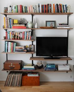 Perhaps for my living room. there are always more books and stuff for shelves! and would still have room for art supplies. Small Space Living: 25 DIY Projects for Your Living Room Track Shelving, Diy Shelving, Open Shelving, Basement Shelving, Rustic Shelving, Shelving Brackets, Wall Shelving Living Room, Tv Brackets, Metal Shelving