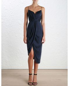 Zimmermann's navy-blue midi dress is crafted from silk that hangs and drapes beautifully. With slender shoulder straps and a plunging neckline and back, this elegant style has a draped asymmetric skirt and a fully boned bodice. Style yours with sandals and metallic accessories.