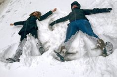 Some people took advantage of the snowstorm travel ban to have fun – Bianca Hillier, left, of Columbus, Ohio, and Eloise Pollard of London make snow angels on a normally busy stretch of Manhattan's Tenth Avenue at West 34th Street in New York. AP Photo/Jennifer Peltz
