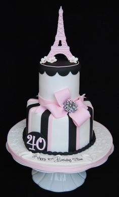 Eiffel tower 40th birthday cake - All fondant except for brooch in the center of the bow.