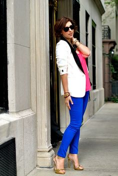 We adore Christine's chic yet casual look! Her white tuxedo-style blazer rocks paired with cobalt pants and a hot pink top.