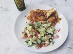 Chicken sniztel and cucumber / tomato salad