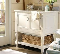 DIY-How To Build a Pottery Barn Inspired Vanity -great idea for laundry room or poring bench too.