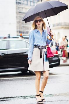 A blue button up is worn with an a-line skirt and black accessories.
