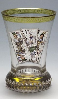 "Ranftbecher.Anton Kothgasser Vienna c. 1820 Ground clear glass, partially glazed yellow, colored painted, front three playing cards ""Trull"" of Tarokspiels with three trumps Sküs, moon and Pagat conical wall on vertical geschlägeltem Ranft, lip with floral border, back golden lettering ""Leur union est notre force "", in the ground floor"